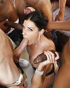 Ultra sexy Brunette cock loving MILF, India Summer, is dipping her fingers into her soaked hot pussy waiting for four cocks to invade her craving pink tight pussy. One by one we offer our throbbing poles into India's hot mouth, pussy and of course her tiny little butt hole. India was so dick hungry she had meat in all her holes and hands until we left her dripping with come from head to toes.