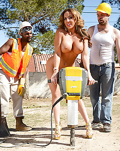 "When Richelle Ryan got cat-called by some asshole construction workers, she decided to call their bluffs by hiking up her skirt, shaking her thick booty, and telling them to whip out their big cocks. Unfortunately for her, just as she was starting to really get horny, their boss Johnny Sins told them to get back to work! Never one to take ""no cock"" for an answer, Richelle marched into Johnny's office and demanded he satisfy her wet pussy! She sucked and fucked his fat dick, even getting pounded from the back while she was locked up in Johnny's kinky sex stocks! Once she was finally satisfied, she marched out to take the jackhammer for a test drive, making her big fake tits and amazing booty bounce beautifully!"
