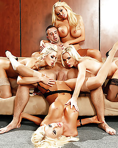When Courtney Taylor, Nikki Benz, Nina Elle, and Summer Brielle come complaining to boss-man Keiran Lee about his asshole friend Buttler, it's got him in something of a tight spot. Buttler is always sexually harassing the busty blondes, and they've finally had enough. They offer Keiran an ultimatum: either he goes, or they do. Keiran considers his options, fantasizing about the buxom beauties giving him a slow and sexy striptease before tasting their tight wet pussies one by one. They take turns sucking and fucking Keiran's fat cock, licking and fingering each other's tight pussies while Keiran fucks them hard. Finally, he unloads a massive facial all over all of their beautiful smiling faces, and breaks from his reverie. But the decision remains: friendship or big tits?