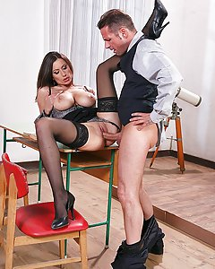 During class David starts doing very sexual jokes to teacher Sensual Jane, with indignation she dismisses class except for David. Before she starts talking, David pulls out a bunch of porn movies where Jane is the star. She feels embarrassed and he asks her to fuck him or he will tell everyone about her pass. With no other option she fucks the shit out of him and get his well deserved load on her huge tits.