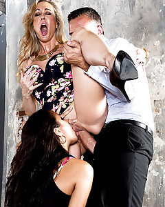 Brandi Love and her husband Keiran Lee are starting a business, and just bought a warehouse to build their first location. Only trouble is, when they get there to inspect the grounds, they find a runaway named Abbey Lee Brazil squatting! Keiran wants to kick her out, but Brandi sees her tight body and thinks of a better idea. She pulls off Abbey's top, revealing the gorgeous tits underneath, and suddenly she has Keiran's attention! Those sluts suck his fat cock and then take turns fucking him, cumming all over his dick and squealing with pleasure. Keiran blows a big load all over both of them, and it looks like Abbey won't be getting in any trouble after all!