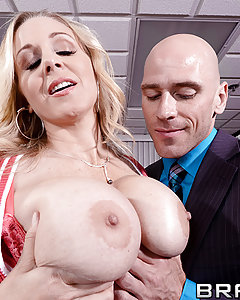 Julia Ann's one Milf whose hands-on approach to life goes a little too far sometimes. When she visits her son at his work, it doesn't take long for the manager Johnny to notice what a hot piece of ass she is. Julia heads right back to the boss's office, convinced that with a little help, her son is headed right for the top.