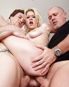Kissy Kapri loves sex and in this scene you can see the hot blonde get banged hardcore. Kissy is obsessed with cock and she gets four at once in this orgy party. The guys take turns fucking her ass, mouth and pussy and before the scene is over, they have her go air tight and swallow four loads.