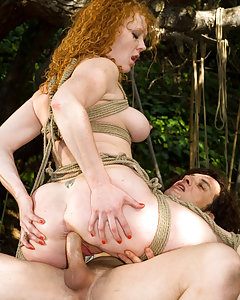 Naughty red haired slut tied up and fucked hard in the ass