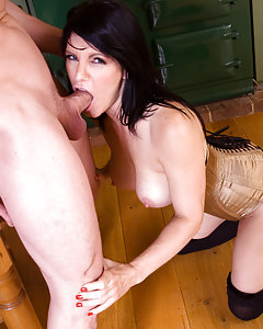 Amazing milf in corset, stockings and high heels is fucking