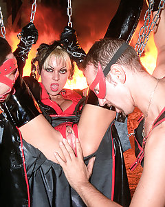 Big brutal fetish orgy with leather suits chains and fire