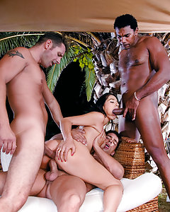 Three gorgeous brunette models fucking dicks in a big orgy